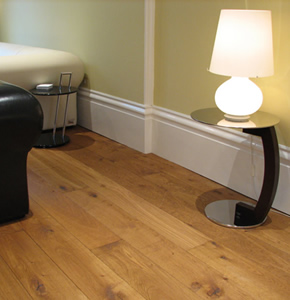 Smoked oak planks with deep profile skirting for a house in Putney, London
